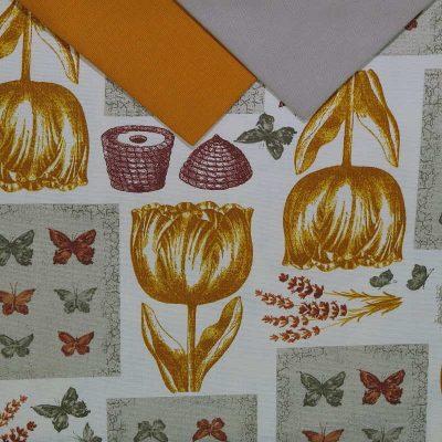 Tovaglia 12 posti con tovaglioli che riproduce Tulipani gialli e un patchwork di varie grafiche