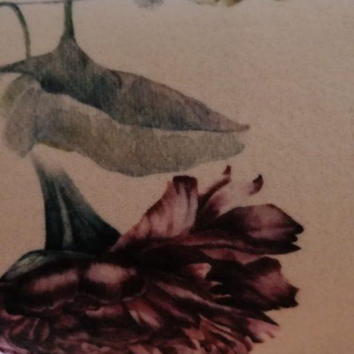 Coperta Plaid in pile di cm. 160x200 con un disegno di motivi floreali in tonalità pastello