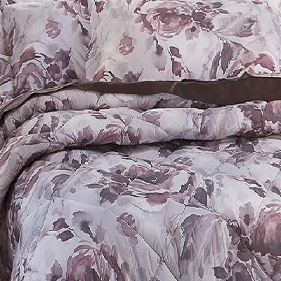 Plaid coperta in pile tinto e sovrastampato con grandi fiori sulle tonalità del rosa